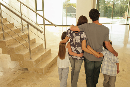 Family hugging in new house
