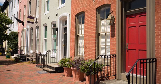 Row of brick houses on a residential street in Baltimore, MD