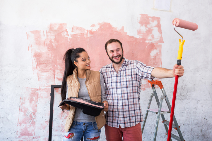 Young couple making home redecoration